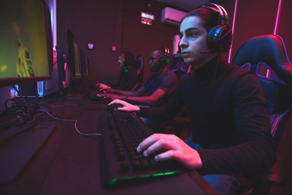 E-sports gamers on gaming chair